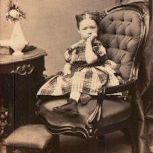 Thumbnail of a older photograph depicting a girl sucking her thumb