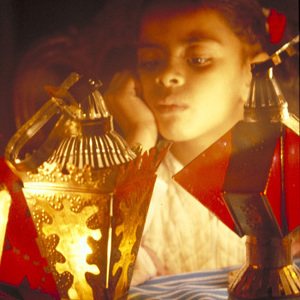 Thumbnail of girl looking at lantern
