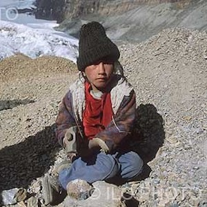 Thumbnail of photo of boy sitting on the ground