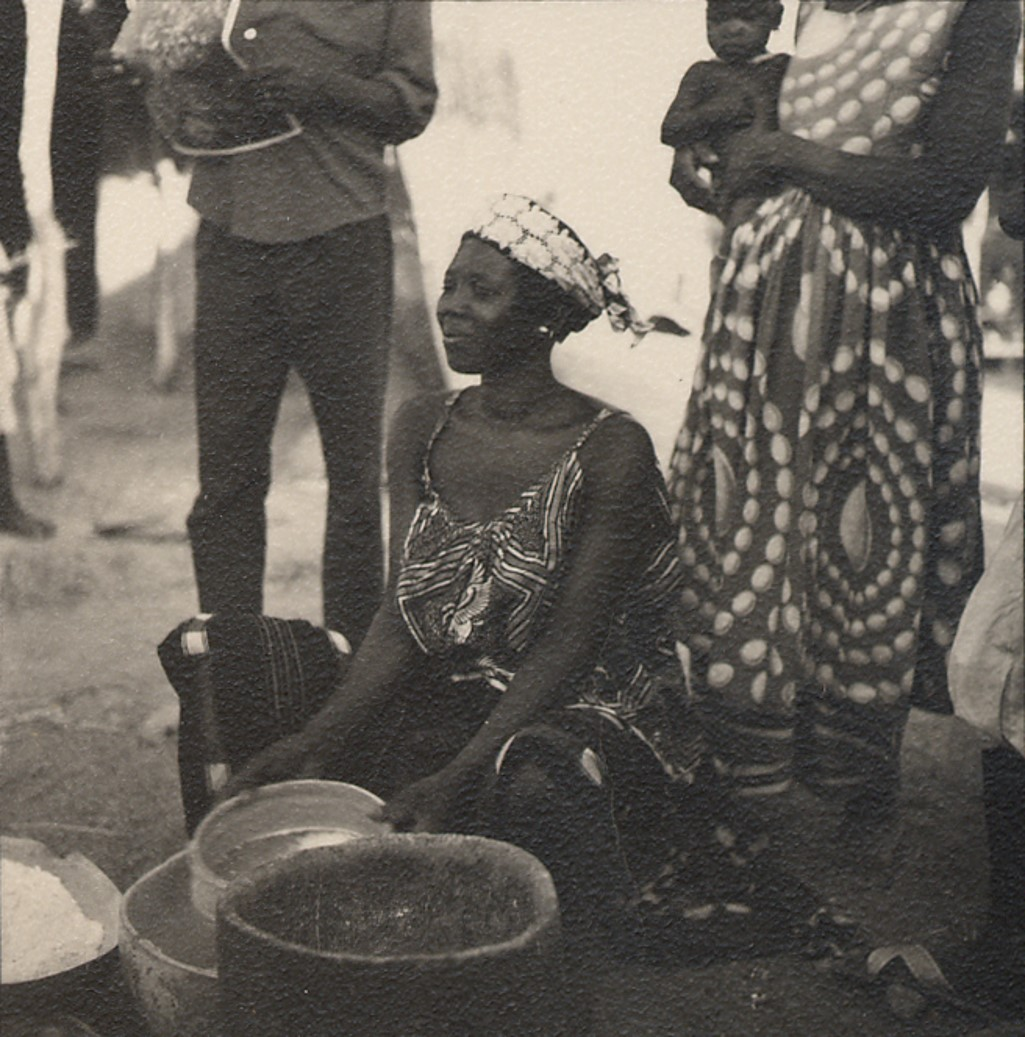 Photograph of a woman making couscous