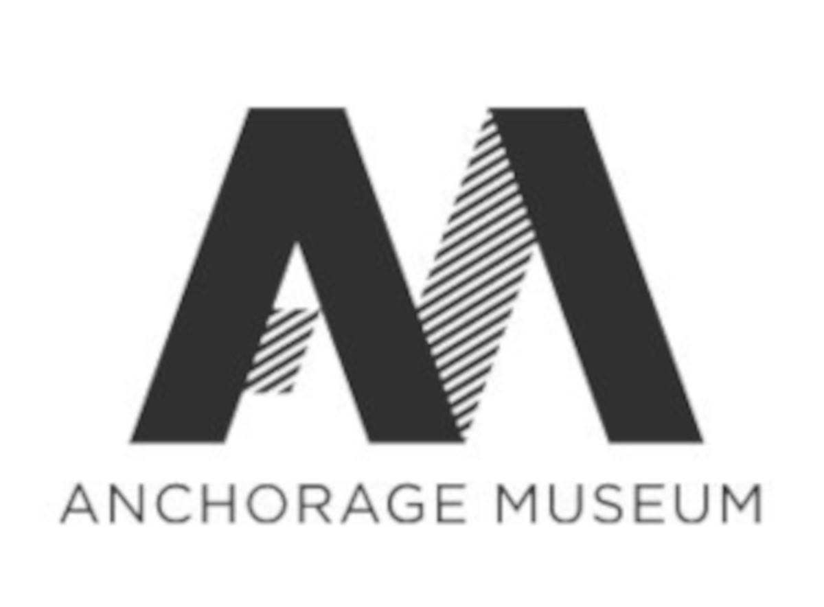 Logo of the anchorage museum which is a wide M, with one of the humps have a line through it, symbolizing an A