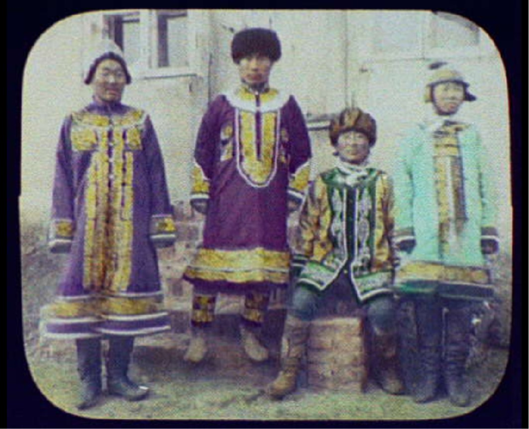 """Photograph of 4 people titled """"Goldi chiefs in best clothes north of Khaborovsk"""""""