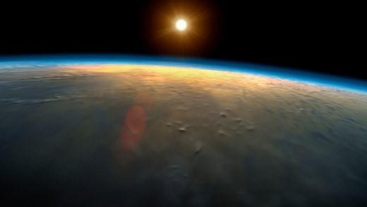 Sun raising over the earth