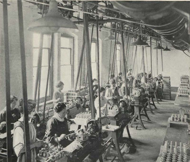 Black and white photo of women working in a factory