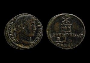 Front and back of aged coins. One side has a side profile of a person and the other has an insignia.
