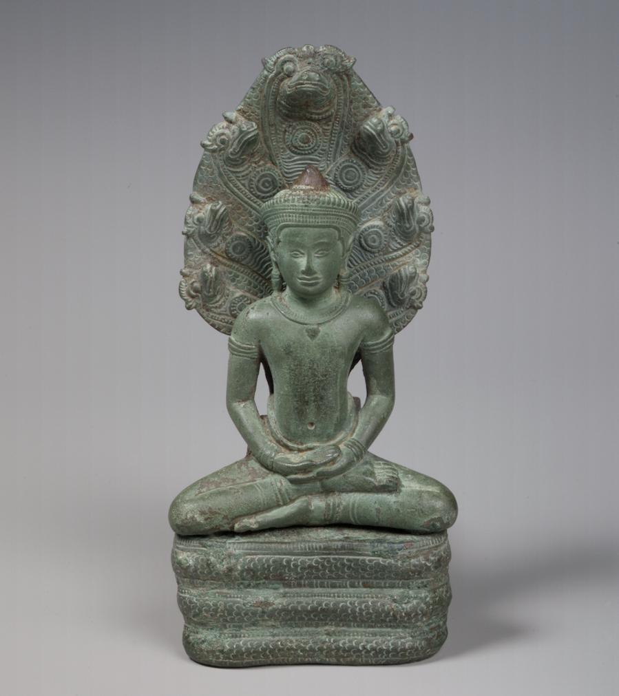 Bronze sculpture of Buddha sitting under a tree