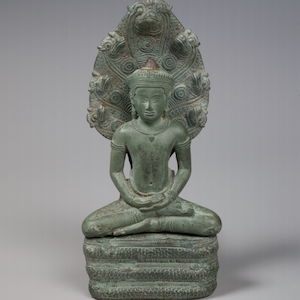 Bronze sculpture of Buddha sitting under a tree