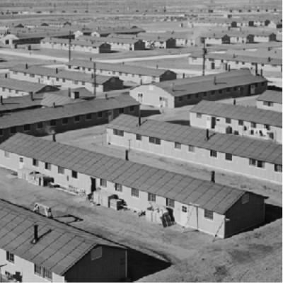 """Detail of a photograph titled """"General view of Granada incarceration camp"""" show rows of internment housing facilities"""