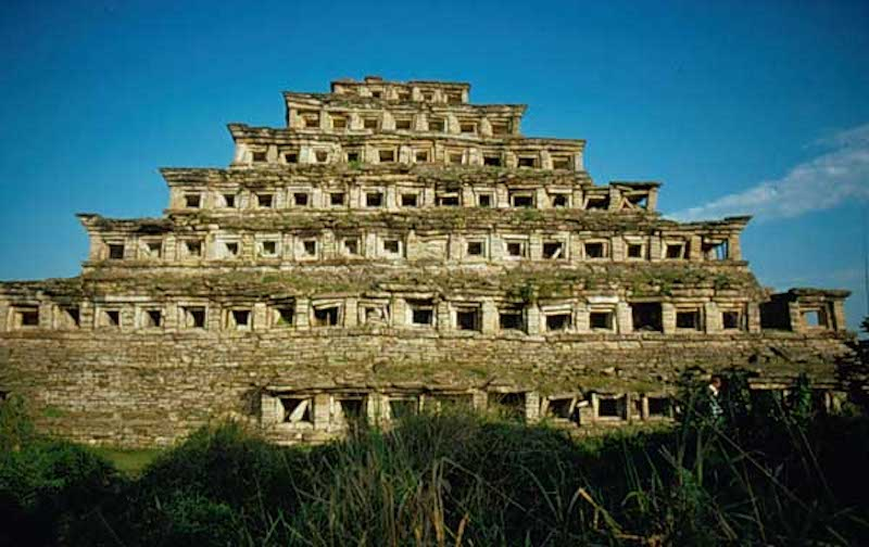 Photo shows an ruins of an ancient temple with 6 tiers