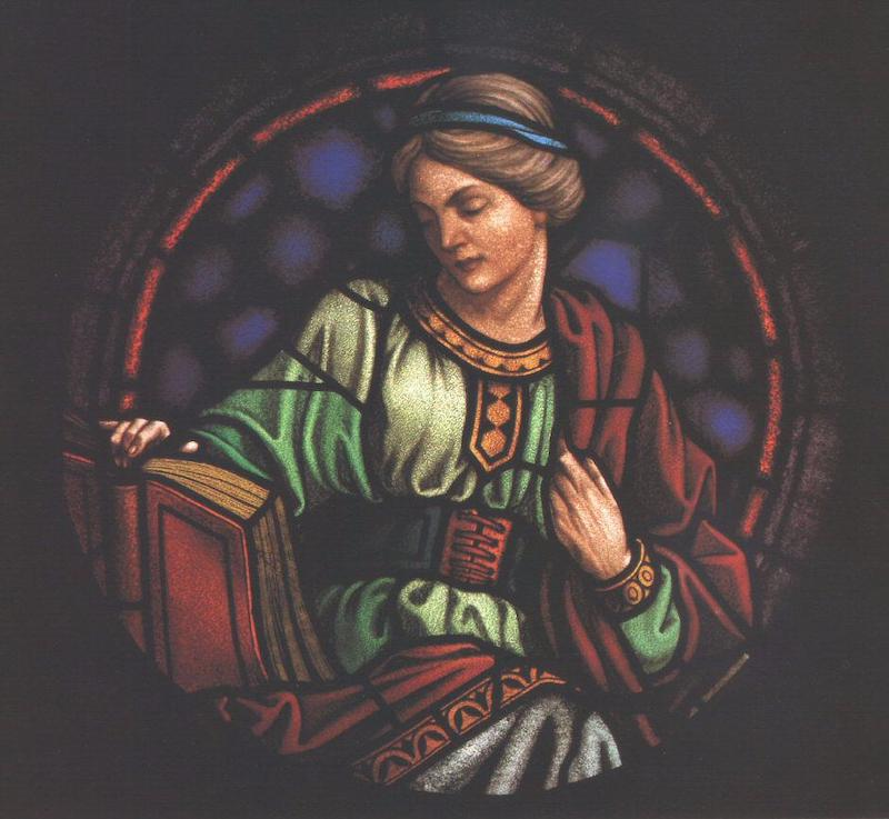 Image on stained glass of a woman reading a book