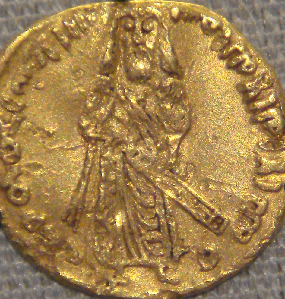 Gold coin engraved with a man holding a scepter
