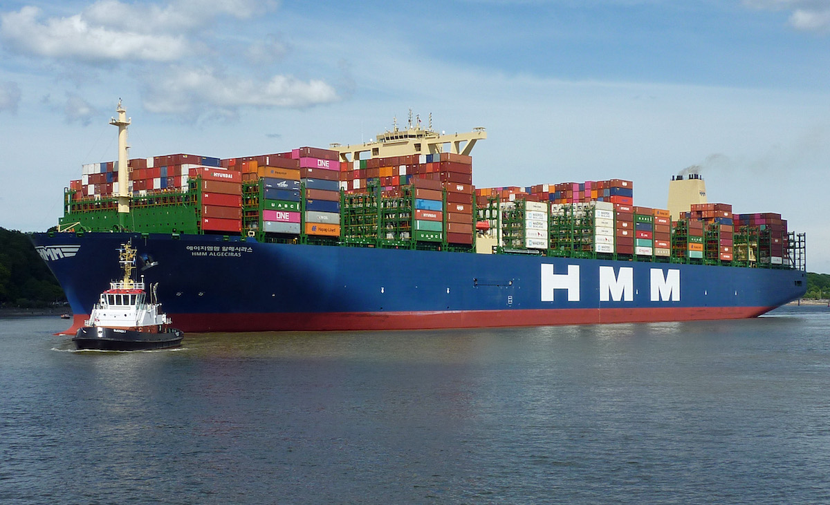 Photograph of a large ship loaded with shipping containers