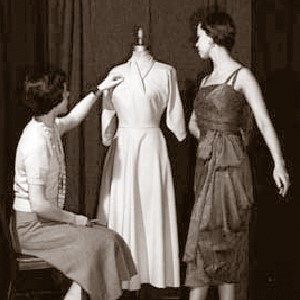 Image of two women making a dress on a dummy