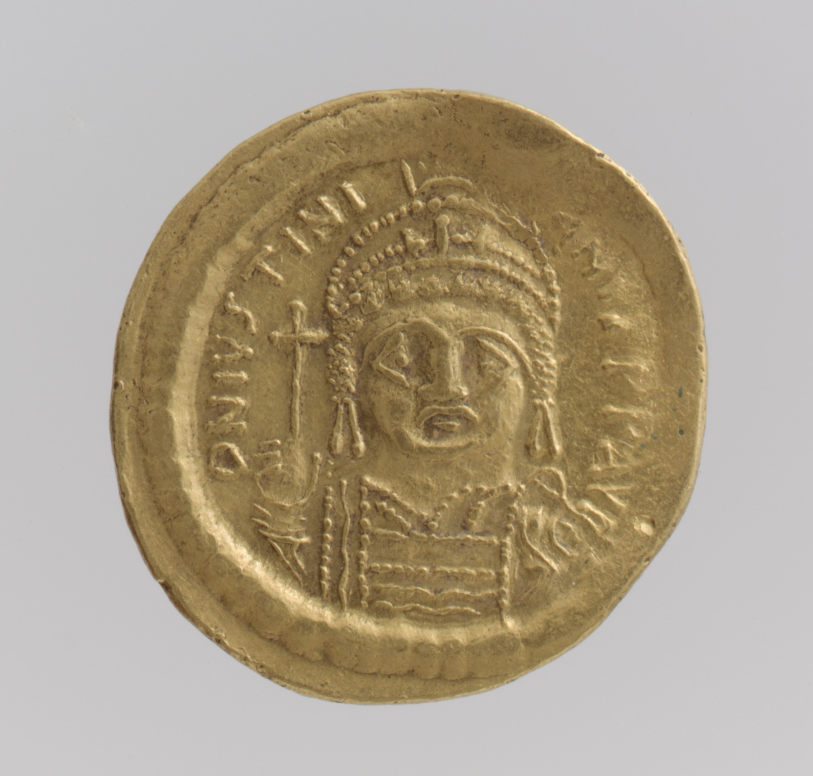 Gold Coin featuring an engraved image of a man with a crown