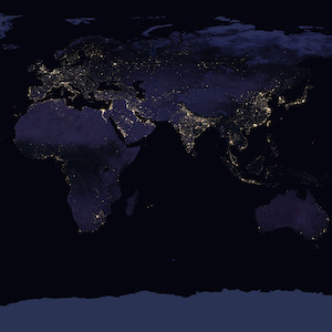 Map of the earth showing areas where lights can be seen from space at night