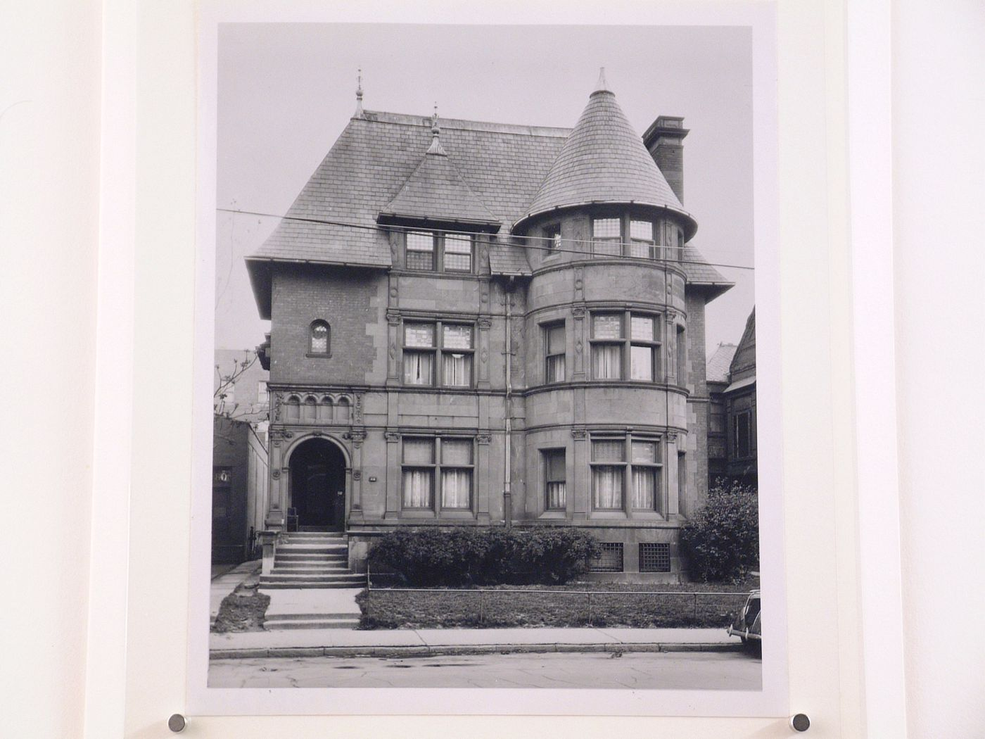 Photograph of a three story mansion with a turret