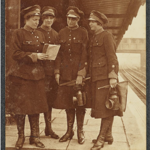 Photograph from the collection of Metropolitan Railways Assistant Guards 'Consulting the Working Book'