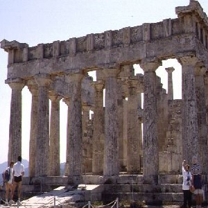Image of the front of Aegina, Temple of Aphaia by Maria Daniels.  It shows the ruins of a Greek temple with the remaining columns standing.