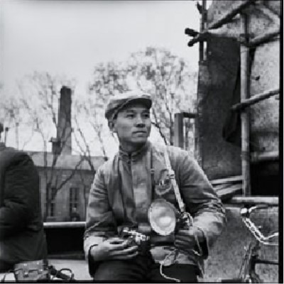 Photograph of Li Zhensheng with his camera in 1965