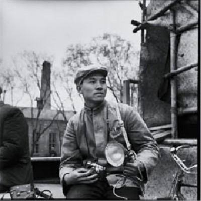 Photograph of Li Zhensheng with his camera in 1965