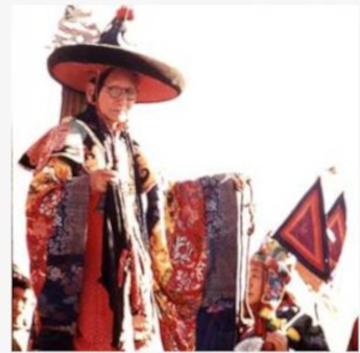 Black Hat Lama preparing for religious sacrifice at the New Year's ceremony, Sikkim
