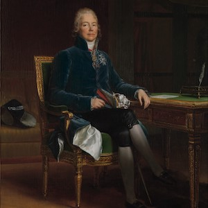 Portrait of a man sitting at a table