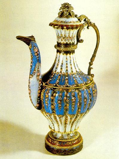 A 19th century silver and enamel plated ewer that looks like a blue and floral decorated, elongated teapot