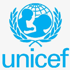 The image shows the UNICEF logo depicting in solid blue a parent holding a child in front of a sphere marked with latitude and longitude lines representing the globe.