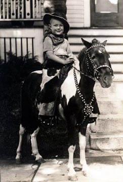 A photo of a child on a pony