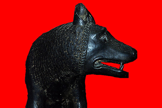 Carving of a black wolf's head