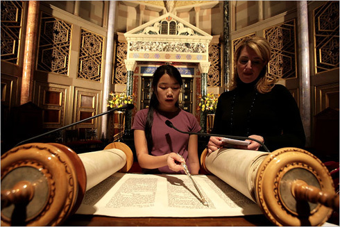 Photograph of girl reading from Torah