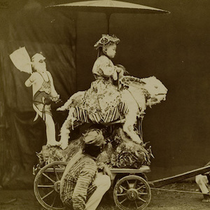 Thumbnail of a photo of a child in costume riding a creature