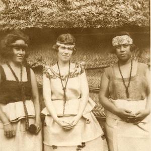 Margaret Mead standing between two Samoan girls image thumbnail