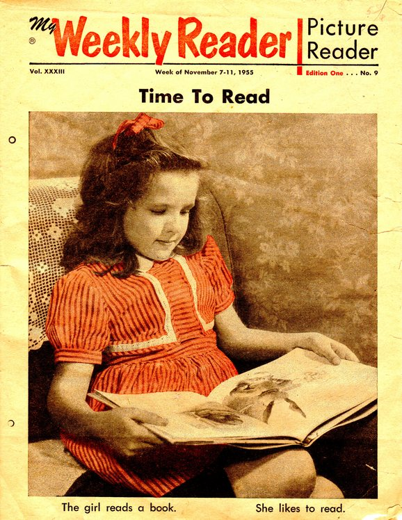 Magazine cover of young girl reading book