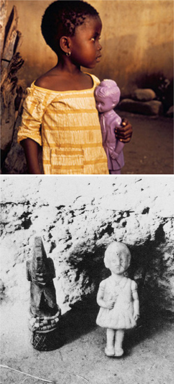 Photo of Asante girl holding plastic baby doll
