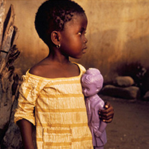 Thumbnail of girl holding plastic baby doll