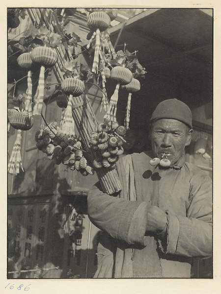 Photo of old man selling toys