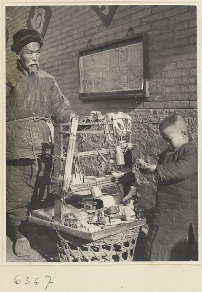 Man and boy standing with toys to be sold