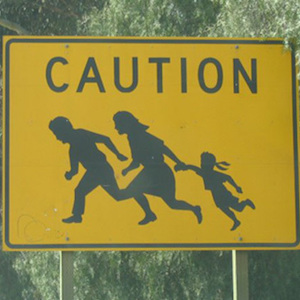 Thumbnail image of Immigrant Crossing Road Sign