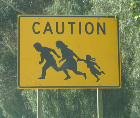 Immigrant Crossing Road Sign