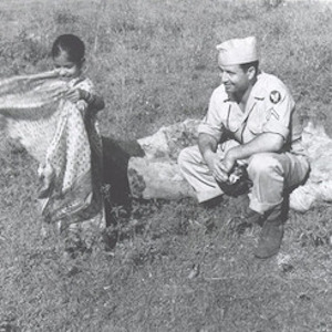 Thumbnail of soldier with child