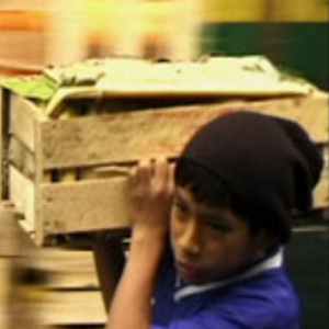 Video still image of child carrying fruit from Peruvian Youth Center for Child Laborers