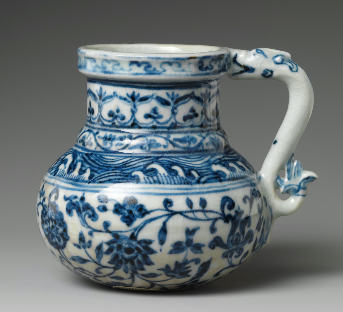 Porcelain tankard with blue ornate decorations