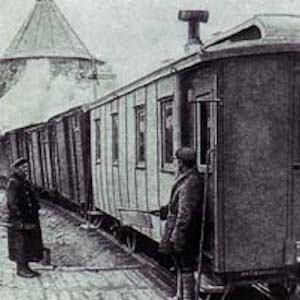 Black and white photograph of train standing at station