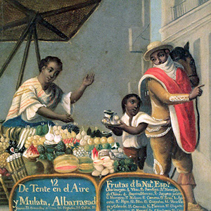 Thumbnail of woman selling items in the street