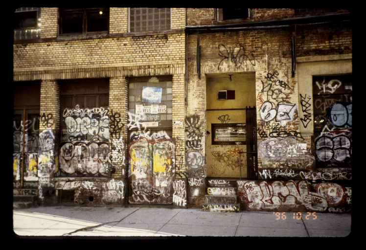 Photo of a wall covered in graffiti