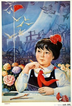 Photo of little girl at desk with Chinese propoganda in background